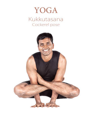 Yoga Kukkutasana cockerel pose by Indian man in black cloth isolated at white background. Free space for text and can be used as template for web-site Stock Photo - 11763441