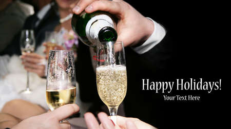Champagne is being poured to the glasses at black background. Represents party. Free space for your text and can be used as template for web design and magazine photo