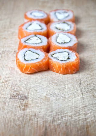Japanese sushi on the wooden textured desk. Free space for your text. photo