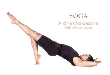 Variation of ardha chakrasana half wheel pose by Indian man in black cloth isolated at white background. Free space for text and can be used as template for web-site photo