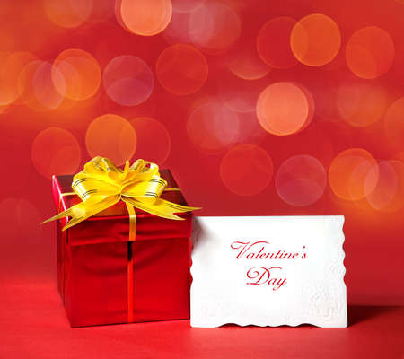Red box with yellow bow and blank white letter with message at red bokeh background. Free space for your text Stock Photo - 11914184