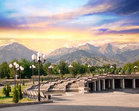 kazakhstan: view to the mountains at sunrise sky background in dendra park of first president Nursultan Nazarbayev in Almaty, Kazakhstan