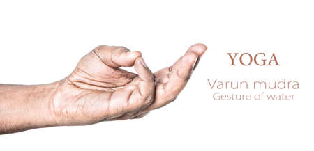Hand in Varun mudra by Indian man isolated at white background. photo