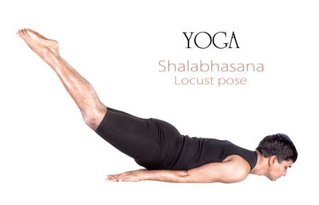 Yoga shalabhasana locust pose by Indian man in black cloth isolated at white background. Free space for text and can be used as template for web-site Stock Photo