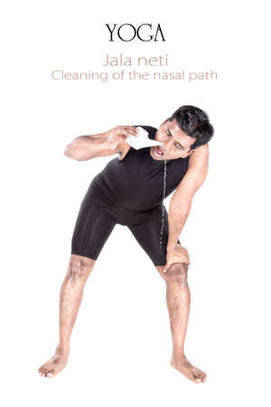 Yoga Jala neti cleansing technique of nasal path by Indian man isolated at white background. Free space for text and can be used as template for web-site