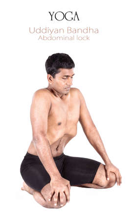 kundalini meditation: Yoga uddiyan bandha abdominal lock by Indian man isolated at white background. Free space for text and can be used as template for web-site