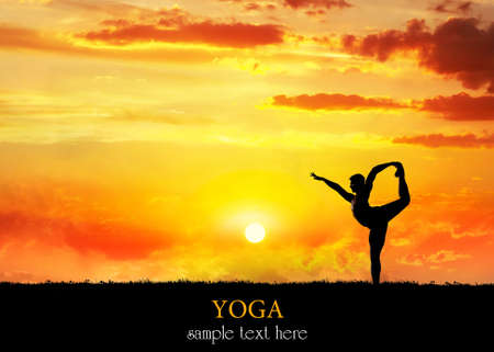 yoga sunset: Yoga Natarajasana dancer balancing pose by Man in silhouette with dramatic sunset sky background. Free space for text
