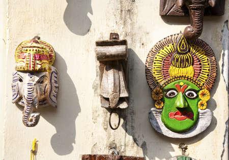 kathakali: Statues of Ganesh God and Kathakali dancer face in Mattancherry Market in Kochi, Kerala, India
