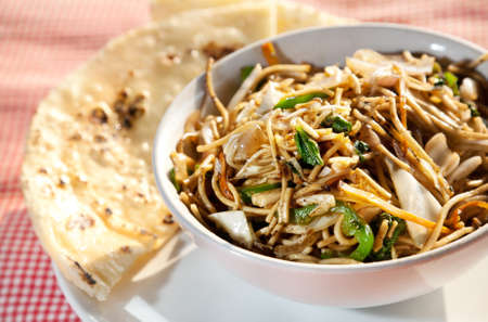 vegs: Vegetarian noodles and butter naan on the table in restaurant in Varkala, Kerala, India