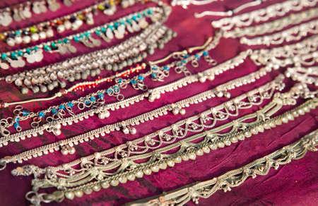 varkala: Various of Indian bracelets for foot at market in Varkala, Kerala, India Stock Photo