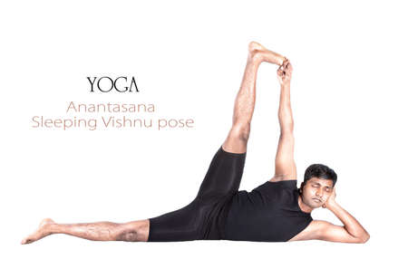 Yoga Anantasana Vishnu pose by Indian man in black cloth isolated at white background. Free space for text and can be used as template for web-site Stock Photo - 13488916