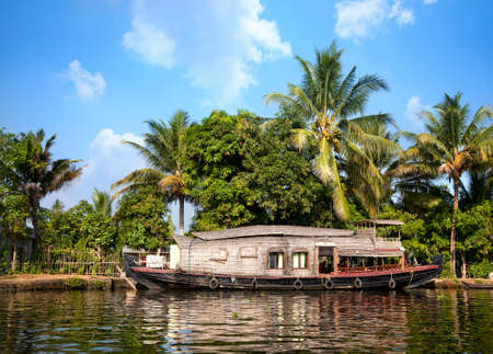 House boat in backwaters at palms background In alappuzha, Kerala, India photo