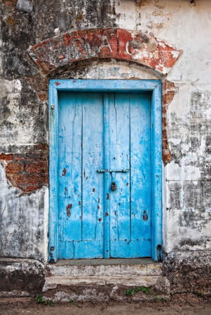 vintage door: Textured vintage blue door and damaged wall in Jew town, Kochi, Kerala, India Stock Photo