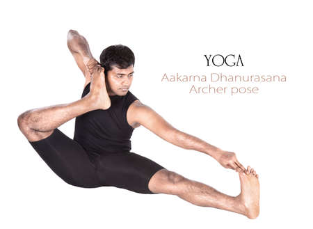dhanurasana: Yoga Aakarna dhanurasana Archer pose by Indian man in black cloth isolated at white background. Free space for text and can be used as template for web-site