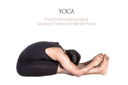 Yoga paschimottanasana forward bend pose by Indian man in black cloth isolated at white background. Free space for text and can be used as template for web-site Stock Photo - 13611991