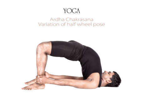 Variation of ardha chakrasana half wheel pose by Indian man in black cloth isolated at white background. Free space for text and can be used as template for web-site Stock Photo - 13697495