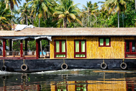 alappuzha: House boat close up in backwaters at coconut palms background in alappuzha, Kerala, India