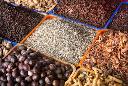 Various of spices at market in India photo
