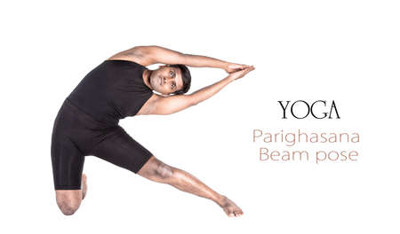 Yoga parighasana beam pose by Indian man in black cloth isolated at white background. Free space for text and can be used as template for web-site Stock Photo - 13950766