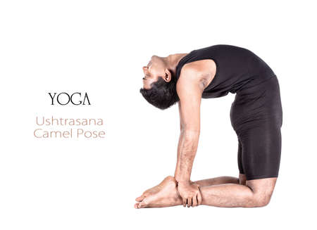 Yoga ushtrasana camel pose by Indian man in black cloth isolated at white background. Free space for text and can be used as template for web-site photo