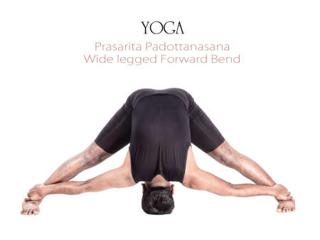 bending forward: Yoga prasarita padottanasana forward bend pose by Indian man in black cloth isolated at white background. Free space for text and can be used as template for web-site