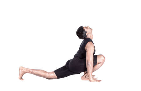 Step of surya namaskar, sun salutation Exercise by Indian man in black cloth at white background photo
