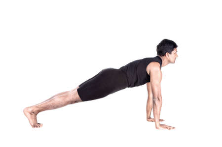 Step of surya namaskar, sun salutation Exercise, plank pose by Indian man in black cloth at white background photo