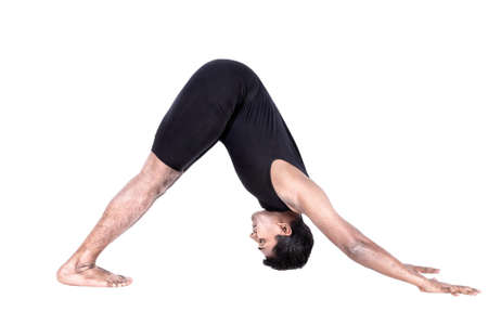 Step of surya namaskar, sun salutation Exercise by Indian man in black cloth at white background Stock Photo - 14099347