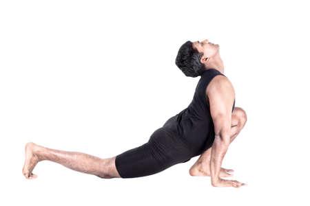 bhujangasana: Step of surya namaskar, sun salutation Exercise by Indian man in black cloth at white background Stock Photo