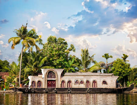 backwaters: House boat in backwaters at palms background in alappuzha, Kerala, India