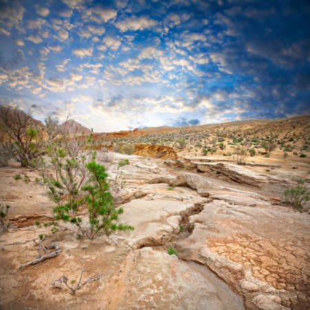 kazakhstan: Aktau mountains scenery with drought earth at dramatic blue sky in national park Altyn Emel in Kazakhstan, Central Asia Stock Photo