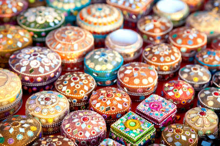 handicrafts: Various of different colorful jewel boxes in Indian market