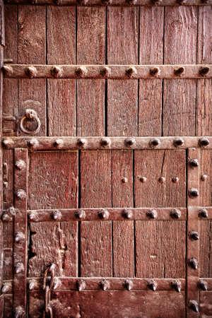 Textured vintage wooden door background in India    photo