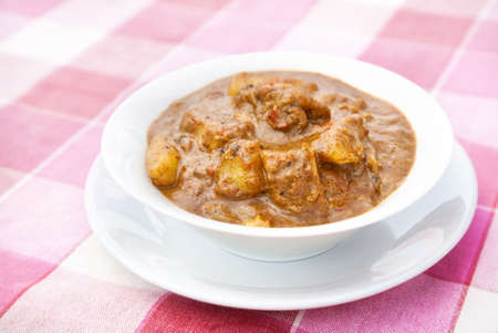 kerala culture: Indian traditional dish aloo gobi potatoes with cauliflower in sauce served in restaurant Stock Photo