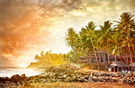 Beautiful view of ocean and tropical coastline with resort and restaurant in Varkala, Kerala, India