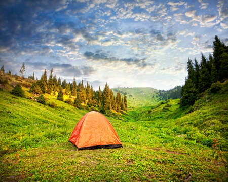 aisa: Tourist orange tent in mountains in Kazakhstan