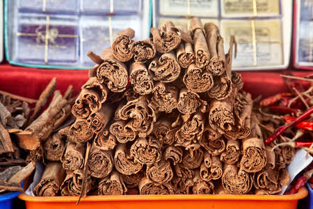 Heap of cinnamon, chili and spices at market in Varkala, Kerala, India   photo
