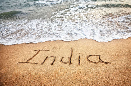 incredible: India title on the sand beach near the ocean