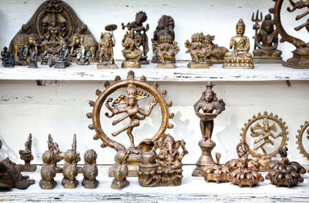 Indian souvenirs of shiva, Buddha, ganesha at flea market photo