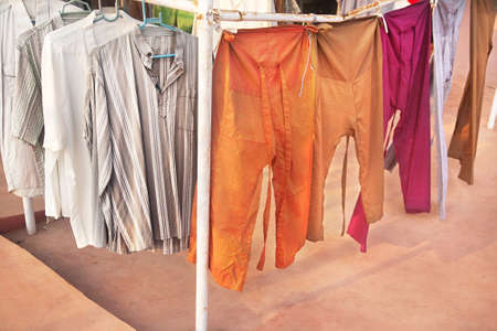 india fisherman: Various of shirts and pants for men at flea market in India