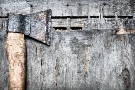 lumberman: Old rusty axe on the textured wooded background