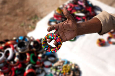 bazar: Indian seller showing various of Indian bracelets at market in Kochi, Kerala, India