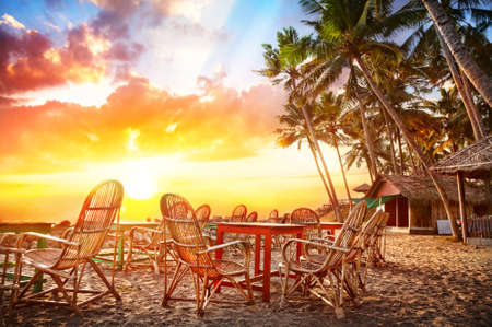 Cafe with beautiful view to the ocean on tropical coastline at sunset background in India Stock Photo