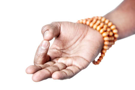 dhyana: Hand in jnana or dhyana mudra with japa mala by Indian man isolated at white background. Gesture of consciousness and knowledge. Free space for your text