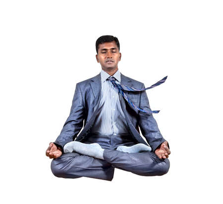 Levitation by Indian businessman in lotus pose isolated on white background. Free space for your text photo