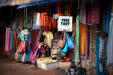bazar: Various of different colorful clothes on Tibetan market and free Tibet banner in India