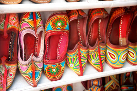bazar: Colorful ethnic shoes on flea market in India