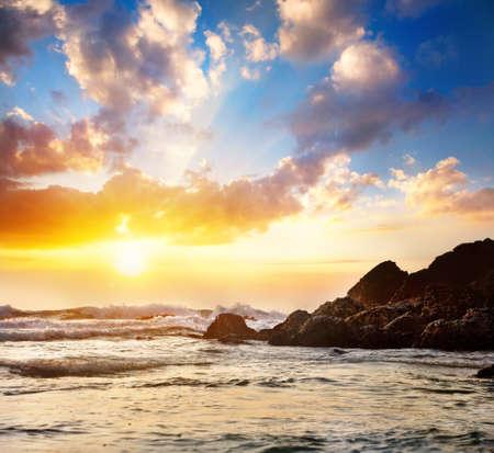 Sea and rock at sunset sky in India, Kerala, Varkala Stock Photo - 17083237