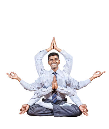 namaste: Indian businessman with many hands in lotus pose with big smile isolated on white background. Free space for your text