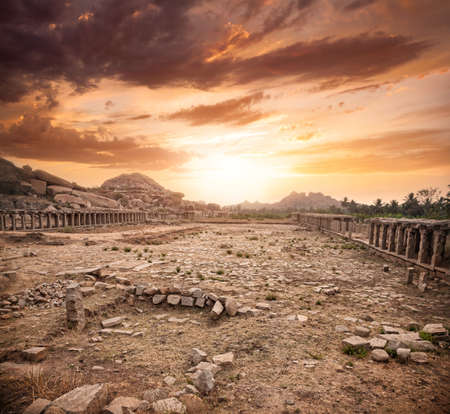 karnataka: Ancient ruins of Vijayanagara Empire at dramatic sky in Hampi, Karnataka, India